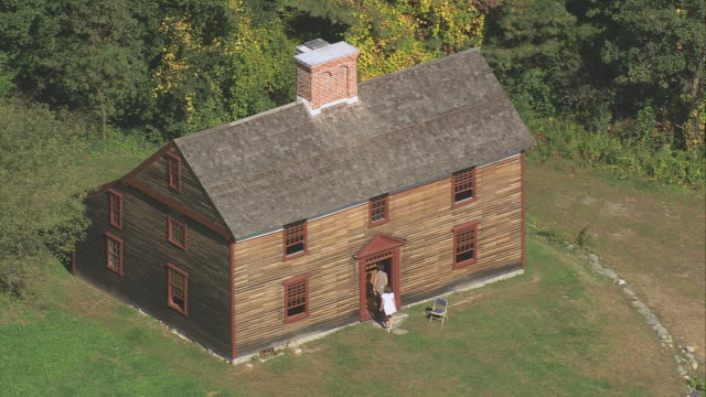 stockvideo's en b-roll-footage met aerial historic cottage preserved for tourists in minute man national historical park / massachusetts, united states - letterbox format