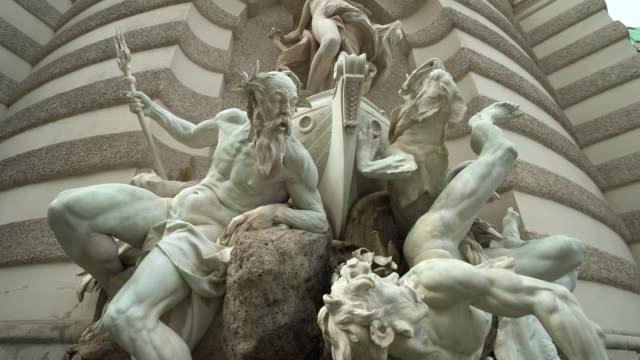 historic fountain vienna michaelerplatz - springbrunnen stock-videos und b-roll-filmmaterial