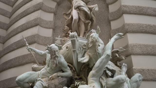 historic fountain vienna michaelerplatz - vienna austria stock videos & royalty-free footage