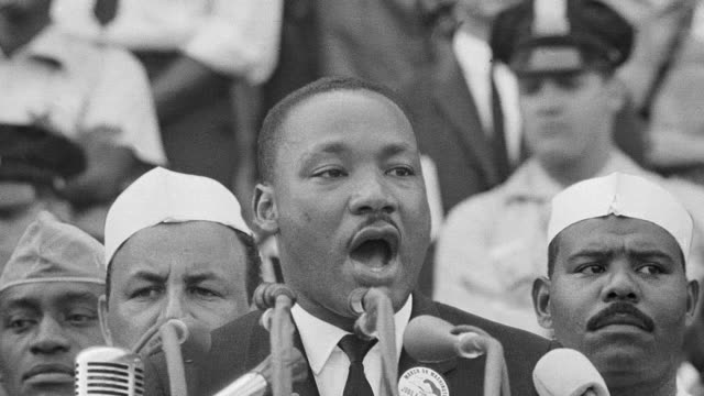 A historic photograph captures a moment of Dr. Martin Luther King, Jr.'s I Have a Dream speech at Lincoln Memorial during the Freedom March on Washington.