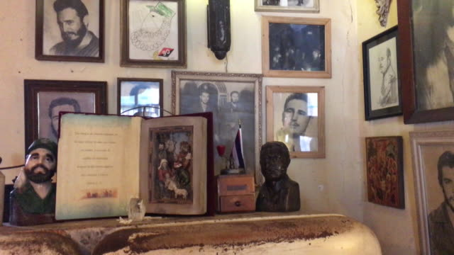 historic photos and objects about fidel castro and the cuban revolution enrich the famous place the cafemuseum belongs to the spanish citizen and... - vena stock videos and b-roll footage
