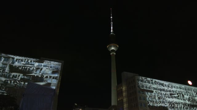 historic pictures and symbols are projected in a multimedia- show on the buildings at alexanderplatz on the first day of events celebrating the 30th... - multimedia stock videos & royalty-free footage