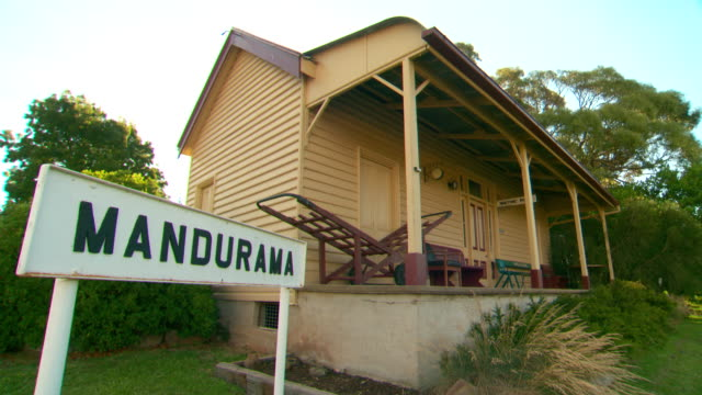 Historic railway signs and station houses 'Mandurama' sign station house 'Neville Siding' sign on windmill 'Waiting Room' sign/ various shots of...