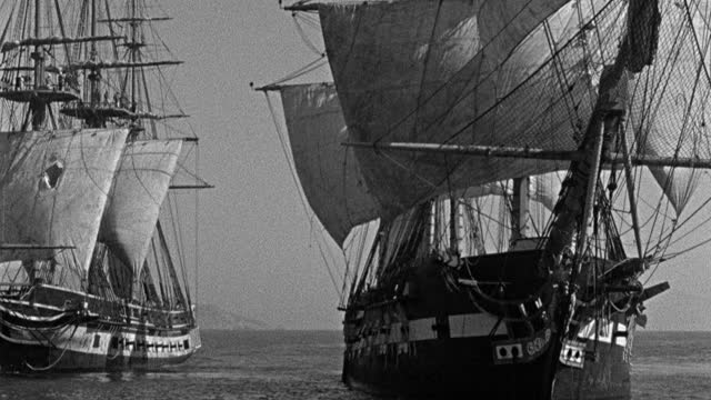 historic reenactment - film montage of smoke drifting around sailing ship in sea, sailing ships sailing in sea - 1945 stock videos & royalty-free footage