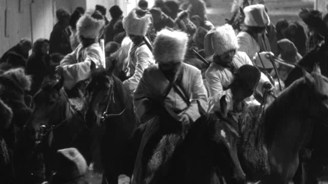 historic reenactment - medium shot of horse mounted cossacks throwing coins to crowd of town people - all horse riding stock videos & royalty-free footage