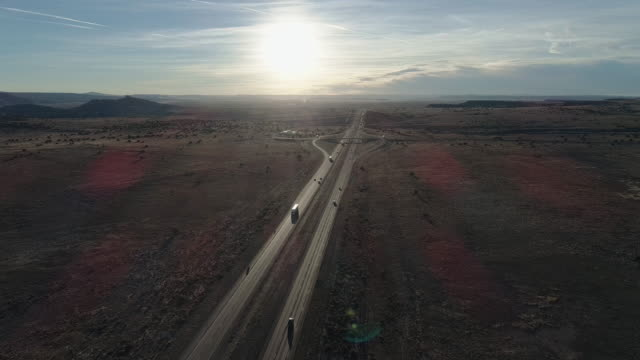historic route 66 - modern highway 40 - near in a desert near laguna, not far from albuquerque, new mexico. aerial drone video with the cinematic forward and ascending camera motion - main road stock videos & royalty-free footage