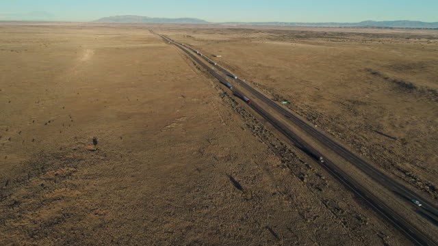 historic route 66 - modern highway 40 - near in a desert near laguna, not far from albuquerque, new mexico. aerial drone video with the slow forward camera motion - tarmac stock videos & royalty-free footage