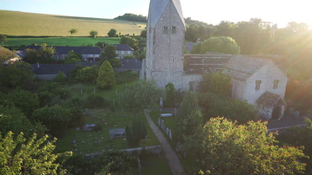 historic st. mary's church aerial, west sussex - プロテスタント点の映像素材/bロール