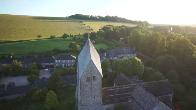 historic st. mary's church aerial, west sussex - kirchturmspitze stock-videos und b-roll-filmmaterial