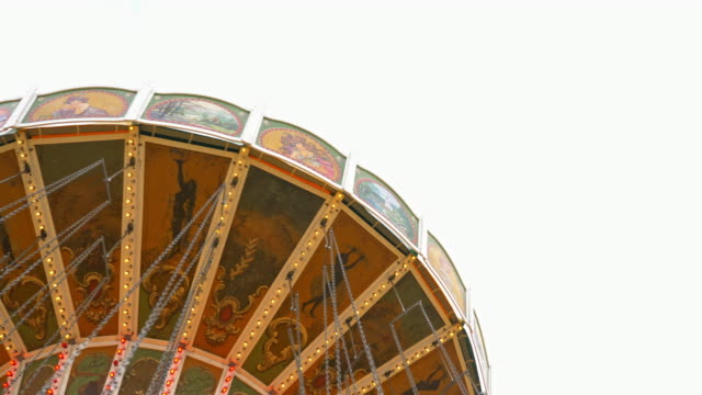 "historic vintage spinning chain swing carousel on the ""Oide Wiesn"" - solid white background"