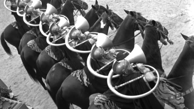 dx - historical - ancient rome - h.c.s. - rear side angle - eight mounted roman trumpeters with odd round trumpets round necks - blow them twice - b&w. - historical reenactment stock videos & royalty-free footage