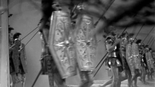 dx - historical - ancient rome - mirror shot - c.s. roman foot soldiers march l to r across screen - b&w. (digi #vt-0159-001) - weaponry stock videos & royalty-free footage