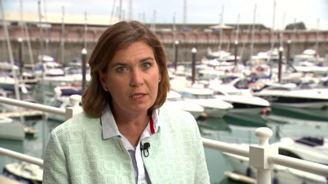 brothel madam 'denies sir edward heath claims' ext reporter to camera - bordell stock-videos und b-roll-filmmaterial