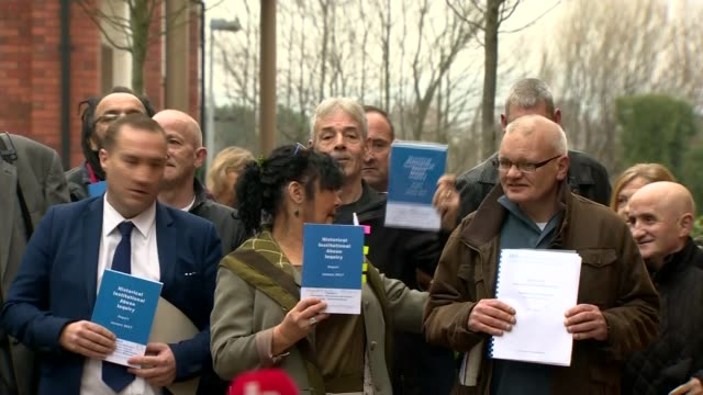 historical child abuse in northern ireland outlined in report northern ireland belfast ext victims of historical child abuse stand holding copies of... - kindesmissbrauch stock-videos und b-roll-filmmaterial