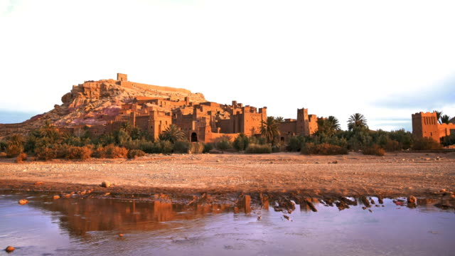 historical complex of aït benhaddou. old brick village on the desert - desert oasis stock videos & royalty-free footage
