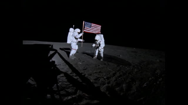 """stockvideo's en b-roll-footage met historical footage: us astronauts planting the stars and stripes flag for """"all of humanity"""". apollo 14 was the third mission of the apollo program to... - maan"""