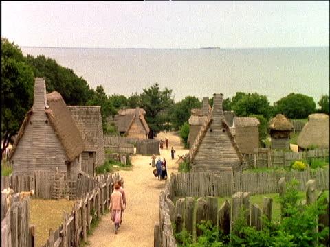 vídeos y material grabado en eventos de stock de historical reconstruction of early pilgrim settlement on shoreside usa - oveja merina