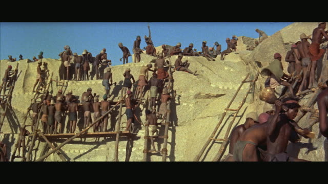 ws historical reenactment, ancient slaves working on rock quarry - slavery stock videos & royalty-free footage