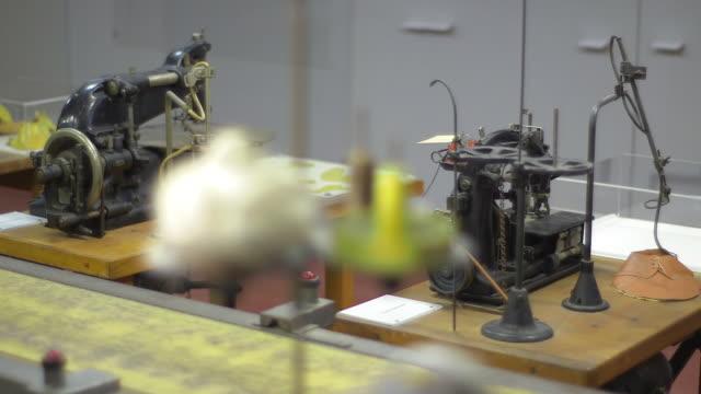 historical sewing machine, sewing cotton,  pan shot