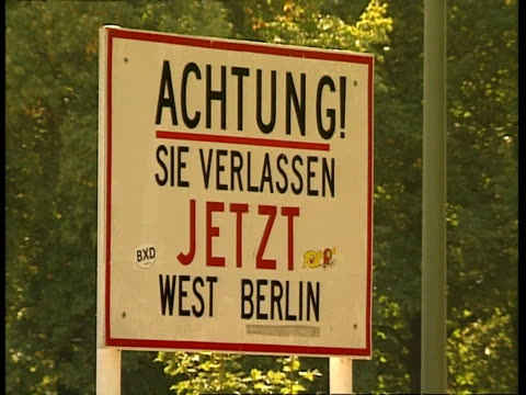 cu historical sign notifying exit from west berlin: 'achtung! sie verlassen jetzt west berlin' (warning, you are now leaving west berlin), berlin - cold war stock videos & royalty-free footage