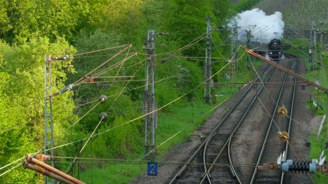historical steam train in saar valley near saarburg, rhineland-palatinate, germany, europe - locomotive stock-videos und b-roll-filmmaterial