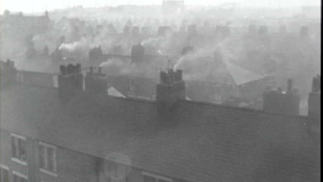 history of smog in london; x05106602 / 1966 london: ext b/w smoke rising from chimneys of houses - smog stock videos & royalty-free footage