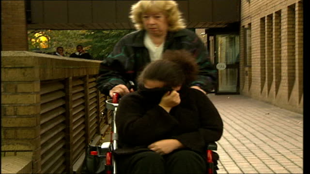 hitandrun driver sentenced to nine years in prison england london southwark crown court ext jean adams along past in wheelchair as covers her face... - サウスワーク刑事法院点の映像素材/bロール