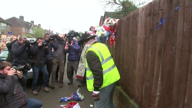 hither green burglar death: flowers torn down from 'shrine' to dead burglar; england: london: hither green: ext various of man pulling down floral... - shrine stock videos & royalty-free footage
