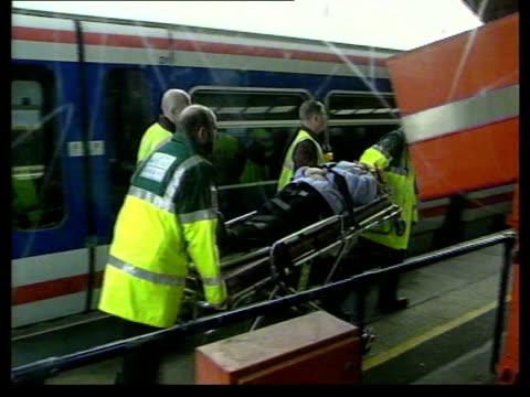 JOYCE OHAJAH ENGLAND London Hither Green EXT GVs Passengers walking along rails away from train as evacuated following crash Injured passenger...
