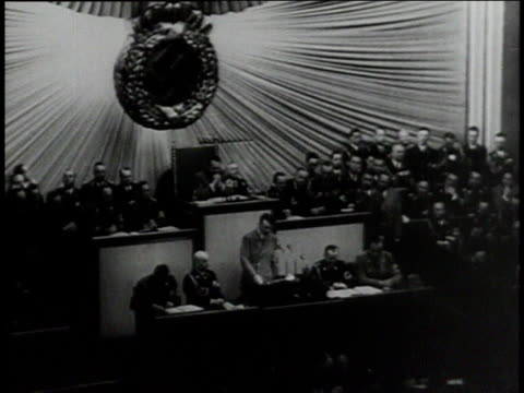hitler addresses crowd / crowd before the greater german seal - adolf hitler stock-videos und b-roll-filmmaterial