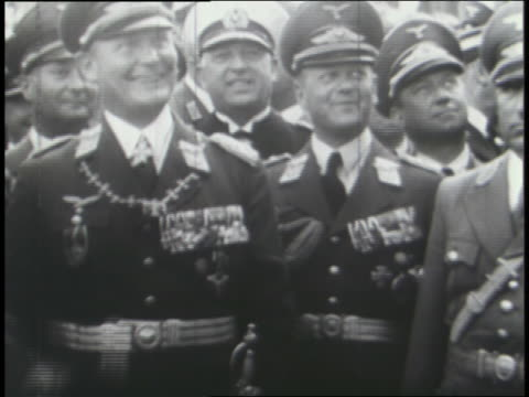 hitler and other nazi officials join in a military parade; crowds cheer; hitler speaks. - saluting stock videos & royalty-free footage