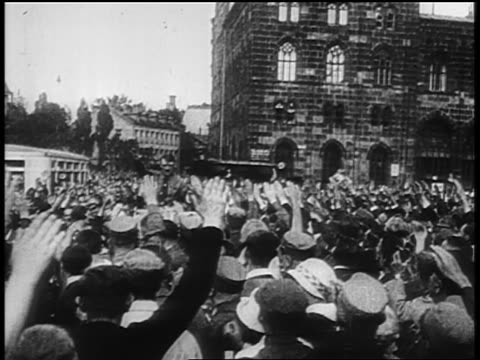 vidéos et rushes de hitler being driven thru crowd giving fascist salute at rally at nuremberg / newsreel - adolf hitler