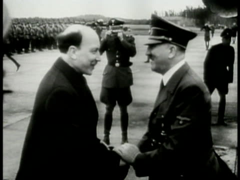 hitler exiting airplane casual nazi salute shaking hands w/ president of finland risto ryti . marshal of finland c.g.e. mannerheim walking near train... - 1944 stock videos & royalty-free footage