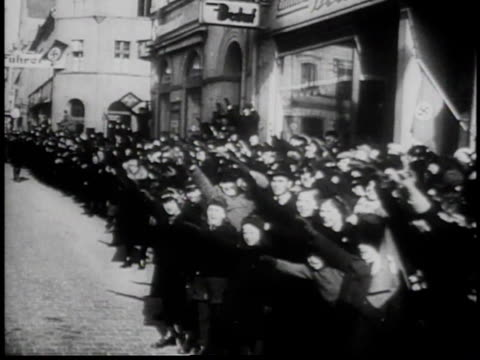 hitler in car driving down street, waving to crowds / crowd cheering and saluting / official in car waving / flag flying above building / government... - tschechische republik stock-videos und b-roll-filmmaterial