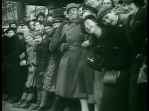 stockvideo's en b-roll-footage met vienna hitler reviewing troops moving in trucks fg smiling people lining street pushing to get better view cu mein kampf book being opened to chapter... - 1938