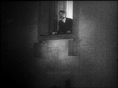 hitler saluting from window at night / just appointed as chancellor - 1933 stock-videos und b-roll-filmmaterial