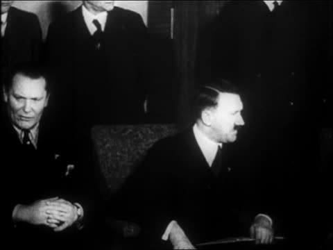 vídeos de stock, filmes e b-roll de hitler sitting between goering + von papen / they stand up / others in background - 1933