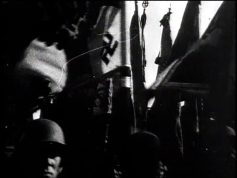 hitler speaking / cannon firing / soldiers marching with flags / soldiers in line / nazi flag waving / soldiers present swords / soldiers play drums... - 1945 stock videos & royalty-free footage