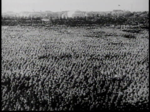 vídeos de stock, filmes e b-roll de hitler speaking on stage / immense crowd listening and cheering speech - adolf hitler