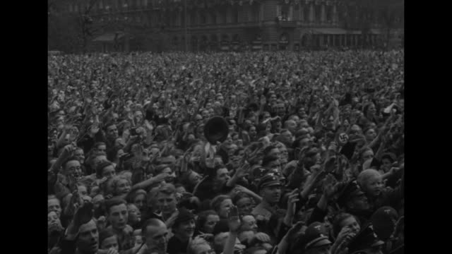 hitler standing on balcony of reich chancellery next to nazi official hermann goering looks down on crowd below and gives them nazi salute / crowd... - hermann goering stock videos & royalty-free footage