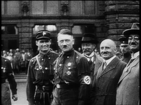 hitler standing with others in dark shirts stepping backwards at nuremberg rally / newsreel - adolf hitler stock videos & royalty-free footage