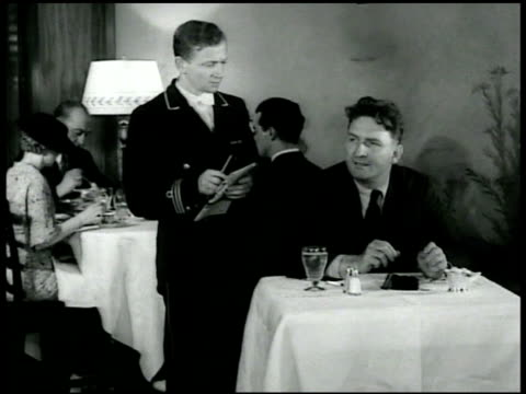 hitler w/ hand to mouth sitting next to hermann goering gerald lk smith ordering whole onion from waiter intertitle 'when assassinated huey long was... - hermann goering stock videos & royalty-free footage