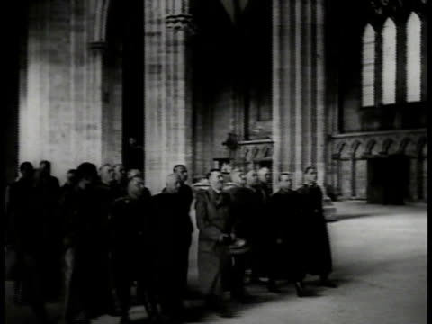 hitler w/ large group of german officials walking inside french national assembly hitler smiling stone pillars bg la ms elaborate stone crucifix... - adolf hitler stock-videos und b-roll-filmmaterial