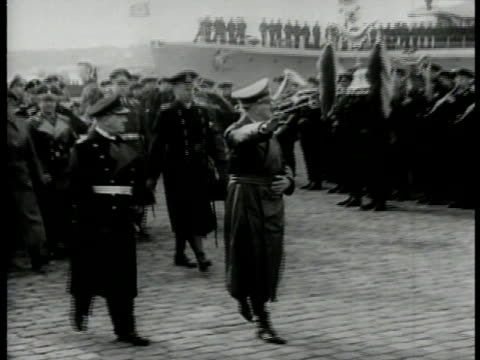 vídeos de stock e filmes b-roll de hitler walking w/ aides officials on harbor docks nazi salute ws hitler on mound w/ officials reviewing german troops marching ha mounted motorcycle... - 1939