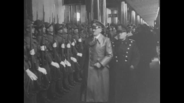 hitler wearing overcoat standing with mussolini in front of line of officers one giving nazi salute / ms rows of italian honor guard presenting arms... - dictator stock videos & royalty-free footage