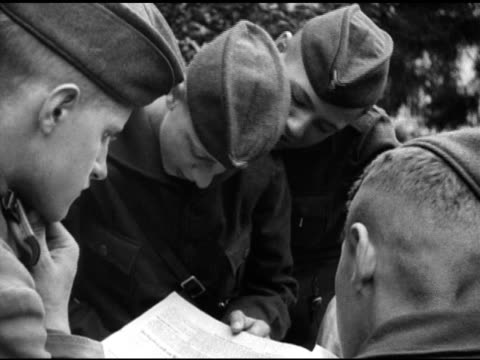 hitler youth male teens gathered at motorcycle, teens reading something, teens in profile. hitler youth male teens looking at rack of postcards.... - letter stock videos & royalty-free footage