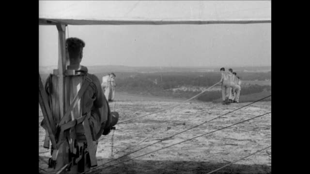 Hitler Youth male teens pulling glider w/ ropes over hill glider in flight over camera HITLERJUNGMADEL Female counterpart to Hitler Youth German...