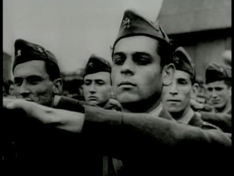 vidéos et rushes de hitler youth walking in long line w/ nazi flags. bulgarian teenagers in uniform saluting marching in street. french teenagers walking in line w/... - adolf hitler