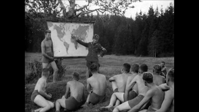 jugend hitler youth young adult males sitting outside german nazi officer w/ world map hanging from tree young adult males sitting outside listening... - prison education stock videos & royalty-free footage