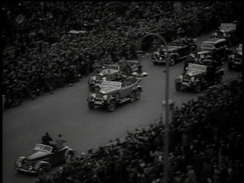 hitlers motorcade arriving in sudetenland and thousands of people line the streets cheering and waving / czechoslovakia - tschechische republik stock-videos und b-roll-filmmaterial